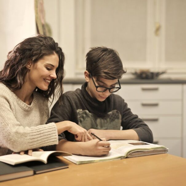 elder-sister-and-brother-studying-at-home-3769981