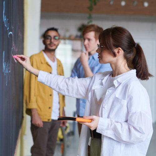 photo-of-woman-writing-on-blackboard-3184644
